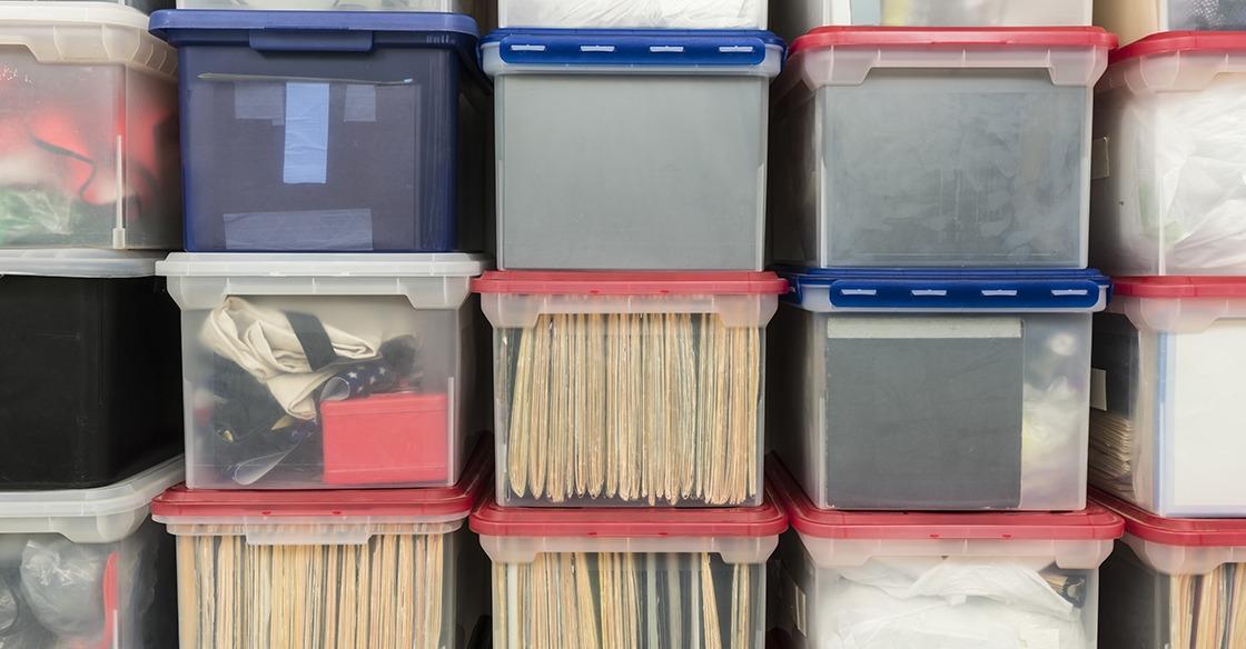 Clear storage bins help with storage locker organization.