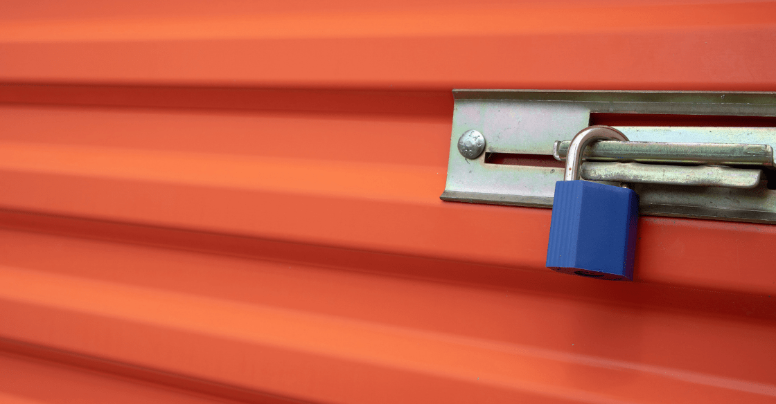 Blue lock on a secure self-storage unit door demonstrates the high security of Storage Locker's facilities.