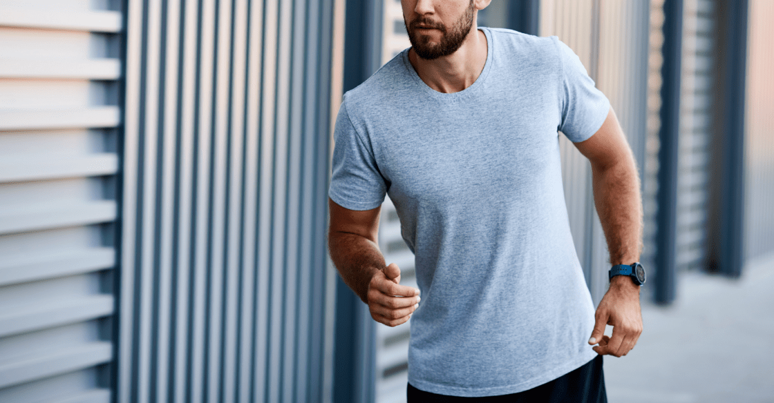 Athletic man jogs near his storage unit gym