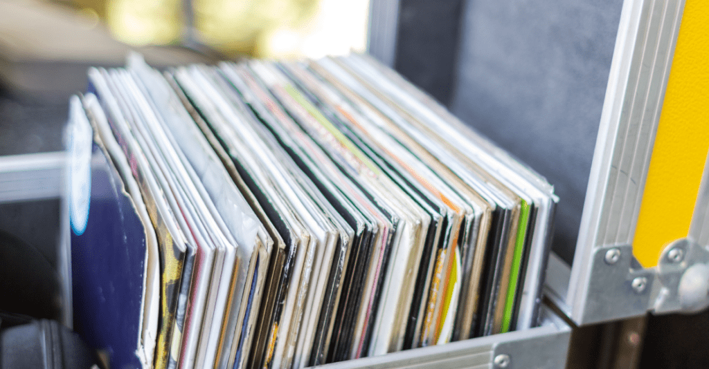 Vinyl records in a metal lockbox, ready for storage.