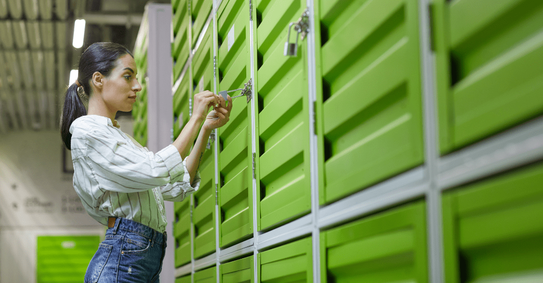 Woman unlocking a storage unit