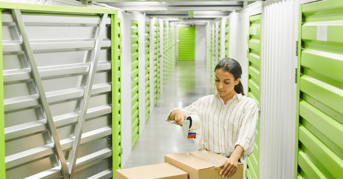Woman storing boxes in her storage unit long term